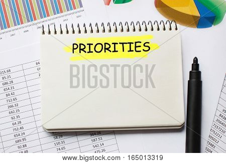 Notebook with Toolls and Notes about Priorities