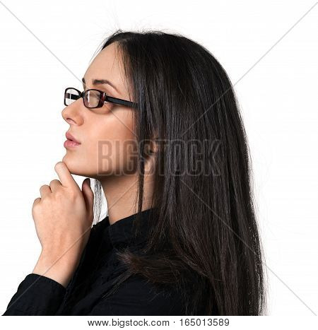 Young woman wearing glasses with her hand on her chin