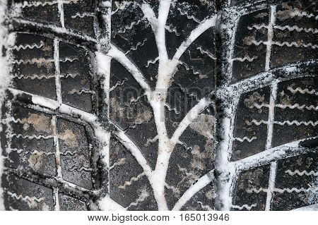 Closeup Of Car Tires In Winter. Winter Tire With Snow