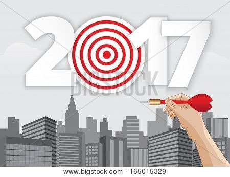 Vector hand holding dart aiming at the business target new year 2017.illustration EPS10