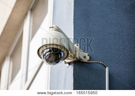 Close-up Of Security Camera Installed On The Wall Of The Building