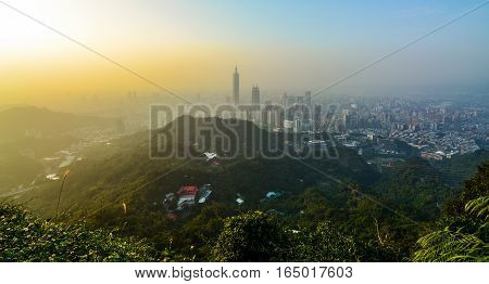 Sunset cityscape of Taipei, Taiwan as seen from a mountaintop overlooking the metropolitan city