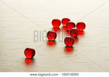 Red caviar on white wooden table, selective focus
