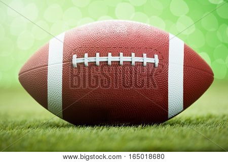 Close-up Of Rugby Ball On Grassy Field