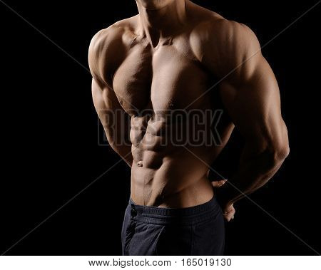 He lives with sports. Cropped shot of a male bodybuilder showing off his ripped abs posing shirtless in studio