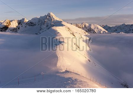 Big mountain peaks at sunset and inversion. Tatry. Poland