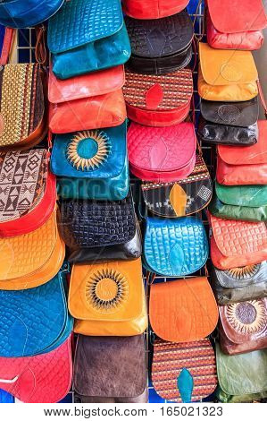 Colorful handcrafted bags for sale at market in Tunisia