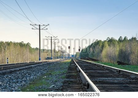 Modern electificated railroad track close to vintage one with wooden sleepers.