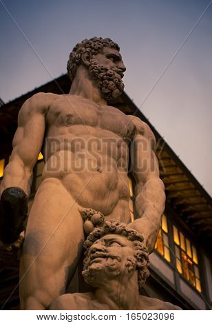 Power and fear on a statue in Florence Italy