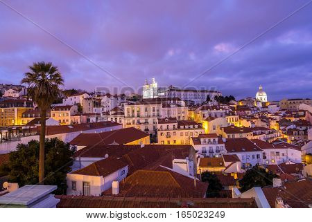 Cityscape of Lisbon Portugal seen from Portas do Sol by night.