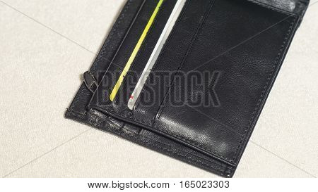An open pocket of black leather wallet with credit cards