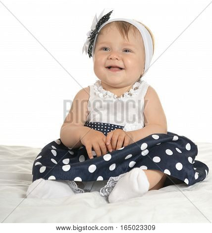 Portrait of Beautiful  baby in cute dress  with flower on her head