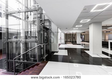 Modern Hallway With Glass Elevator