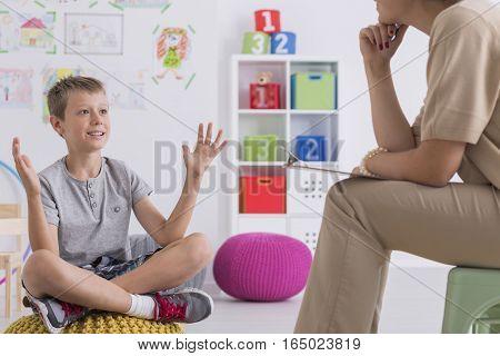 Boy Talking With Psychotherapist