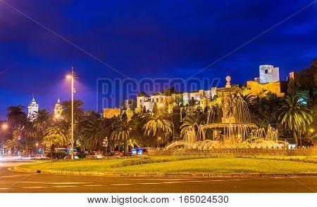 Tres Gracias Fountain and the Alcazaba Castle in Malaga - Adalusia, Spain