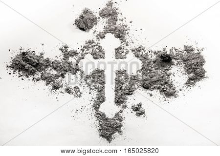Christian orthodox cross symbol made in grey ash dust. Religion concept