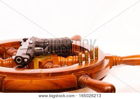 Ships wheel, ammo, pistol with a white background.