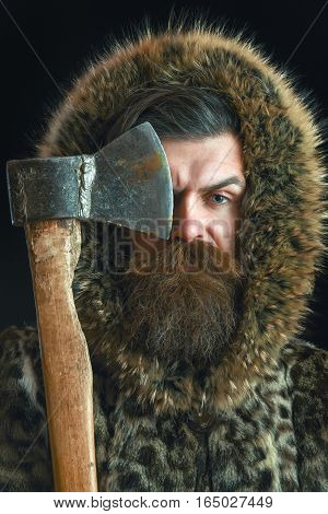 Bearded Man In Fur With Axe