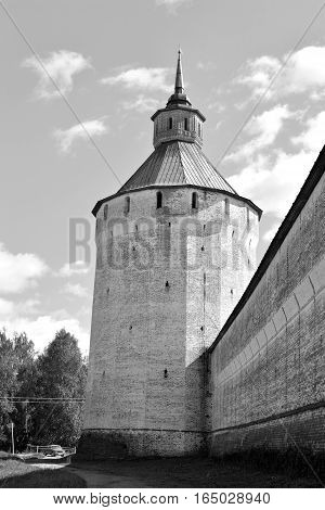 Fortress tower of Kirillo-Belozersky monastery by day near City Kirillov Vologda region Russia. Black and white.