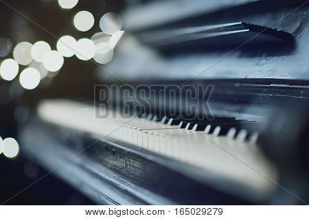 The old black piano. close-up of keys. Beautiful blur