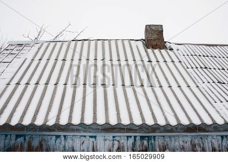 Old slate roof under the snow. Very High Resolution