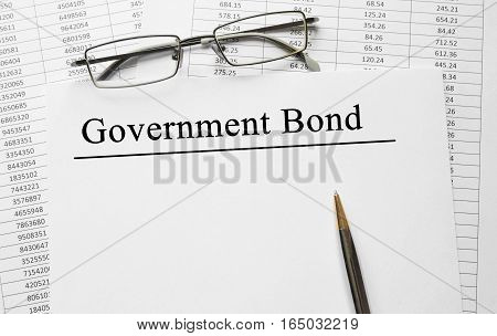 Paper With Government Bond On A Table