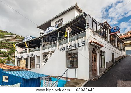 Camara de Lobos Madeira Portugal - December 10 2016: Winston Churchill was a fan of Madeira and spent time in Camara de Lobos. This fish restaurant is named after him.