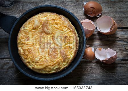 Spanish potato omelette in the frying pan