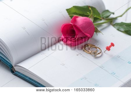 Wedding Gold Rings And Pin On Calender.