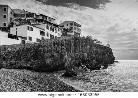 Camara de Lobos Madeira Portugal - December 10 2016: Camara de Lobos near Funchal Madeira Island. In the background Churchill`s corner where Winston Churchill spent much time for paining pictures. Black and white photography.