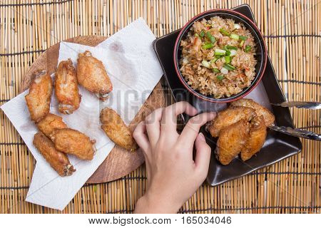 Chef decorated fried chicken wings served with fry rice / cooking fried chicken wings concept