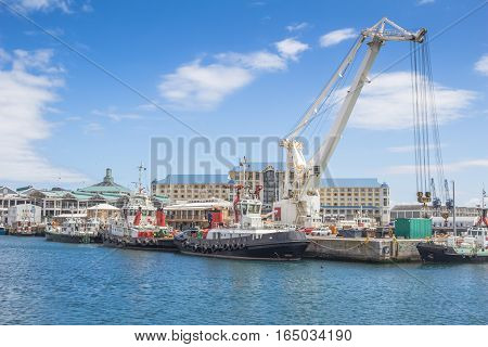 Container crane and boats at Victoria and Alfred Waterfront Cape Town South Africa
