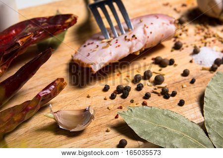 Fork With A Slice Of Bacon On Board Herbs