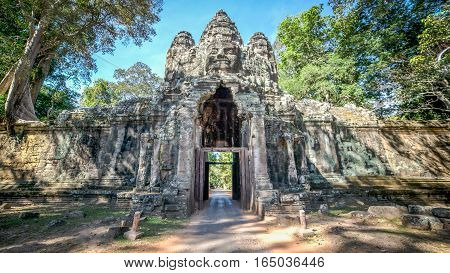 Siem Reap, Cambodia, December 06, 2015: The Bayon gate of Angkor Thom the ancient Khmer empire in Siem Reap, Cambodia.