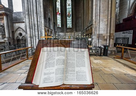 Rouen, France - June 2016: Holy Bible in the interior of Rouen cathedral