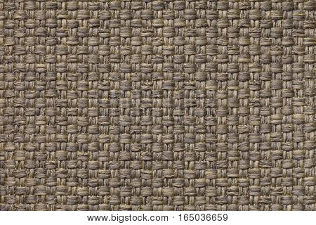 Light brown background with checkered pattern closeup. Structure of the fabric macro.