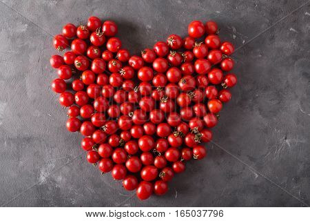 Cherry tomatoes in a hurt form. Colorful tomatoes Tomatoes background. Fresh tomatoes Healthy food concept. Colorful festive still life. Loosely laid tomatoes in different positions.
