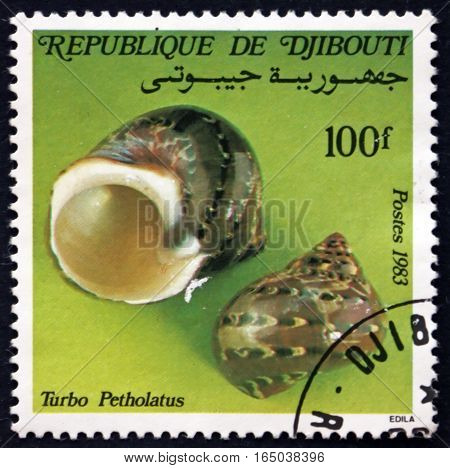 DJIBOUTI - CIRCA 1983: a stamp printed in the Djibouti shows Tapestry Turban Turbo Petholatus is a Species of Sea Snail circa 1983