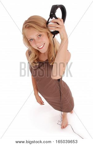 Lovely girl listening a music with headphones white background