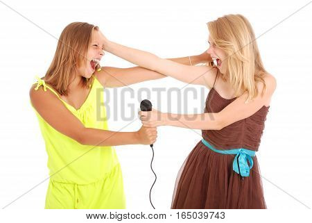 Two beautiful singer teenanger girl singing with microphone - isolated on white