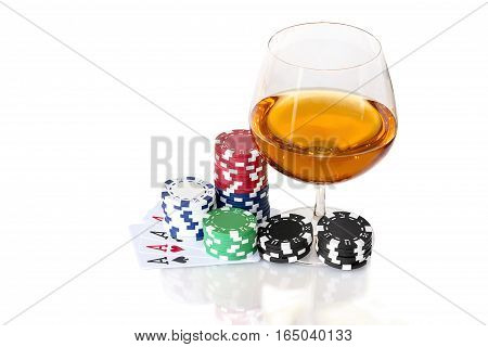Cards to poker with colorful chips and snifter of brandy