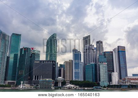 Singapore - December 17 2016: Singapore Cityscape Financial building with Cloudy