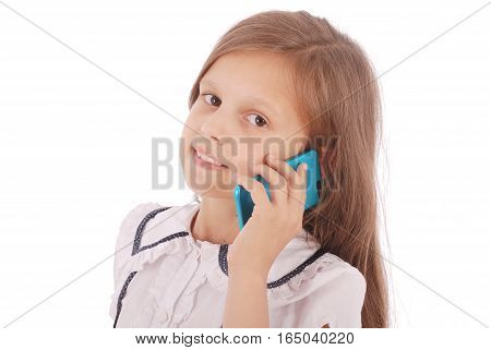 Portrait of beautiful happy young girl talking on smartphone isolated on white