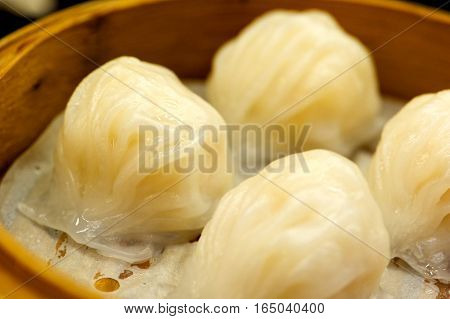 Chinese Steamed Shrimp Dumplings Dimsum In Bamboo Containers Traditional Cuisine