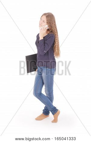 Student teenage girl lying sideways on the floor with laptop and smartphone isolated on white