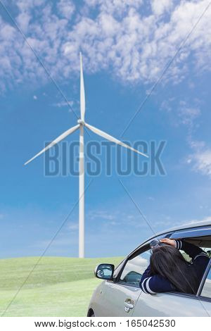 Traveller Photographed The Wind Turbine On Grass Field And Blue Sky