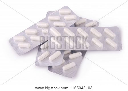 Silver blister with pills on white background with soft shadow. Photo with clipping path