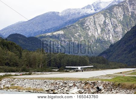 The small plane landing in Skagway town the popular tourist destination in Alaska.