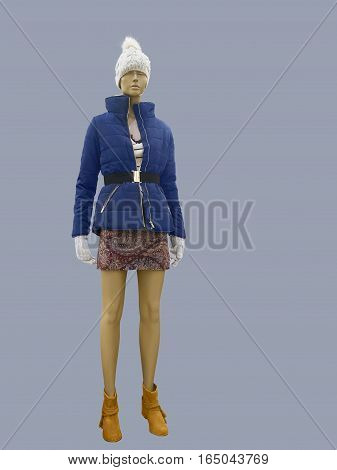 Full-length female mannequin dressed in blue warm jacket isolated. No brand names or copyright objects.