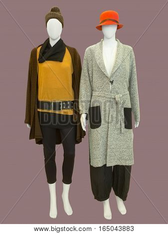 Two female mannequins dressed with fashionable warm clothes isolated. No brand names or copyright objects.